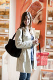 Young woman at supermarket. Young woman shopping at supermarket Stock Images