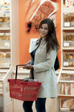 Young woman at supermarket. Young woman shopping at supermarket Royalty Free Stock Image