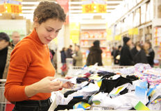 Young woman in supermarket. The young woman in supermarket Royalty Free Stock Photos