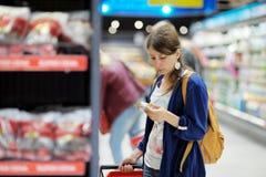 Young woman at supermarket Royalty Free Stock Photo