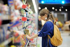 Young woman at supermarket Royalty Free Stock Photography