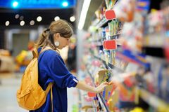 Young woman at supermarket. Beautiful young woman buying food at supermarket Royalty Free Stock Image