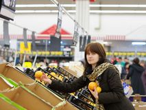 Young woman at supermarket. Young customer buying fruits at market Royalty Free Stock Photo
