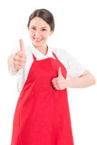 Young woman supermarket employee showing thumbs up. Or like gesture Royalty Free Stock Photography