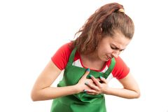 Woman supermarket employee suffering heart pain royalty free stock photography