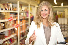 Young woman in supermarket Stock Image