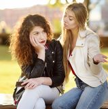 Young woman support and soothe her upsed friend. Young women support and soothe her upsed friend. Two girl during the conversation. Empathy concept stock photo