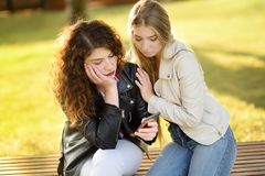 Young woman support and soothe her upsed friend. Young women support and soothe her upsed friend. Two girl during the conversation. Empathy concept Stock Photography