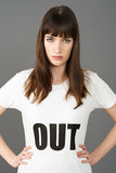 Young Woman Supporter Wearing T Shirt Printed With OUT Slogan Stock Image