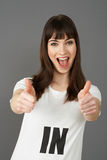 Young Woman Supporter Wearing T Shirt Printed With IN Slogan Royalty Free Stock Image