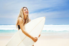 Young woman with surf board Royalty Free Stock Photos