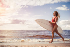 Young woman with surfboard Stock Photos