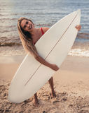 Young woman with surfboard Royalty Free Stock Image