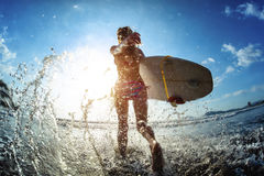 Young woman with surfboard Royalty Free Stock Photo
