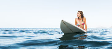 Young woman with surfboard royalty free stock photos