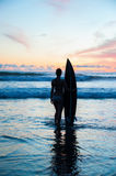 Young woman surfer with board Royalty Free Stock Image