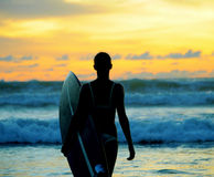 Young woman surfer with board Royalty Free Stock Photography