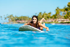 Young Woman Surfing with Her Dog Royalty Free Stock Photos