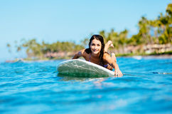 Young Woman Surfing with Her Dog Stock Photography