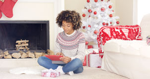 Young woman surfing the internet at Christmas Royalty Free Stock Photos