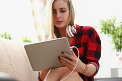 Young woman surfing the internet hold laptop in arms search information. Pretty blond young woman surfing the internet hold laptop in arms search information sit Stock Photography