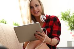 Young woman surfing the internet hold laptop in arms search information. Pretty blond young woman surfing the internet hold laptop in arms search information sit Royalty Free Stock Image