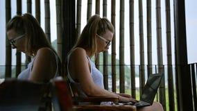 Woman using laptop stock footage