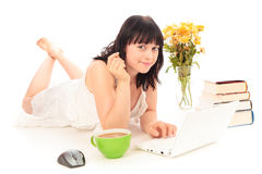 Young Woman Surfing The Internet. Studio shot of a young woman surfing the internet Royalty Free Stock Photo