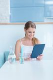 Young woman surfing the internet on a tablet Royalty Free Stock Photos