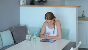 Young woman surfing the internet on a tablet Stock Images