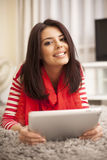 Young woman surfing internet using tablet Royalty Free Stock Photo