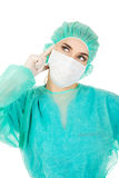 Young woman surgeon doctor thinks about some idea Royalty Free Stock Photos