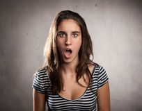 Young woman with surprise expression Stock Photo