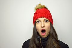 Young woman surprised for cheap price on Black Friday. Copy space. Royalty Free Stock Photography