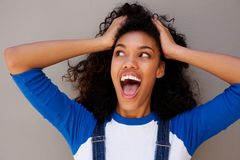 Young woman with surprised expression on face. Portrait of young woman with surprised expression on face Stock Photo