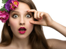 Young woman with surprised expression. With flowers and red lips Stock Images