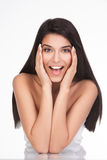 A young woman with a surprised face expression Stock Images