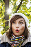 Young woman with a surprised facial expression in autumn park Royalty Free Stock Photography