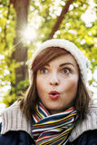 Young woman with a surprised facial expression, retro photo filt. Young woman with a surprised facial expression in autumn park. Seasonal fashion. Beautiful sun Stock Photos