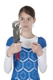 Young woman surprised look to pliers Royalty Free Stock Image
