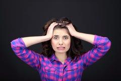 Young woman surprised. A young woman surprised in studio Royalty Free Stock Image