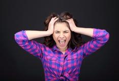 Young woman surprised. A young woman surprised in studio Stock Photography