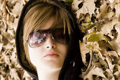 Young woman surrounded by autumn leaves Stock Photos