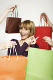 Young woman surrounded by bags Stock Images