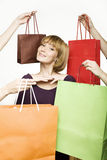 Young woman surrounded by bags Royalty Free Stock Image