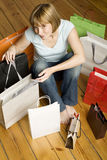 Young woman surrounded by bags Stock Photo