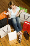 Young woman surrounded by bags Royalty Free Stock Photography