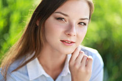Young woman surrounded by green Royalty Free Stock Photos