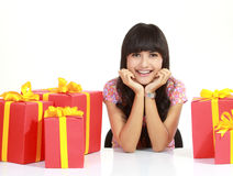 Young woman surrounded by packages Stock Image
