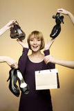 Young woman surrounded by shoes and bag Stock Image